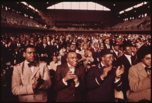 a_portion_of_a_crowd_of_some_10000_muslims_applaud_elijah_muhammad_during_the_delivery_of_his_annual_saviors_day-_-_nara_-_556243