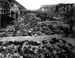 rows_of_bodies_of_dead_inmates_fill_the_yard_of_lager_nordhausen_a_gestapo_concentration_camp